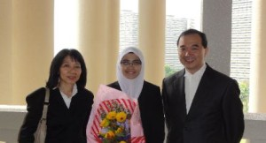 Nazifah Zainun with the mover Ms Aimee Liew and her Master Mr Alex Chang